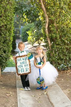 "Cute wedding sign: ""Just wait until you see her"" - how sweet!"