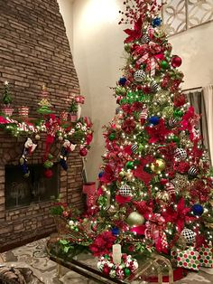 My red, green, gold, black and white 12ft / 14ft Christmas Tree 2016. After decorating this tree the 5 other trees in my home seem easy!!!