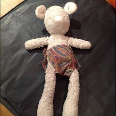FOUND, LANCASHIRE, UK (Nov 2012) A woman in Lancashire found this little white bear in a paisley nappy and is trying to reunite it with the girl who dropped it Hampshire. Contact: @Findmymummy or @lostteddybear or https://www.facebook.com/TeddyBearLostAndFound