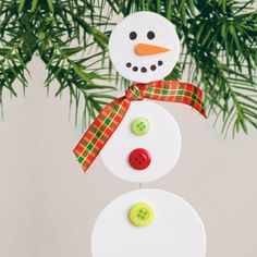 "Dangling Snowman ornament, made from foam sheets. This works better if you use the foam sheets that already have the peel & stick on the back. I also added brown pipe cleaner ""stick"" arms to our snowman."
