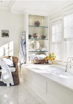 Bath under window, glass shelves