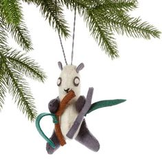Panda Felt Holiday Ornament - Silk Road Bazaar (O) Women in Kyrgyzstan made this ornament by hand from felt. With a loop for hanging the panda measures 4.5 inches tall with 6-inch tall bamboo.