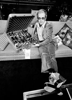 Elton John with his sunglasses collection, 1974.    And of course, his platforms.....