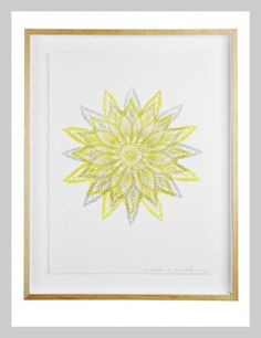 Lumiere Art + Co's silver and yellow star mandala print