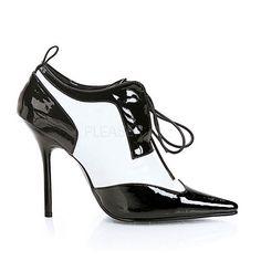 Zwart/witte damesschoenen met veters en hak.