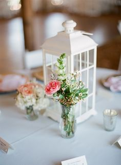LOVE this idea! Vintage lanterns for centerpieces with small mistmatched (thrifted) vases filled with flowers and a few small votive candles around it. Could also paint the lanterns a different, more fall-like color.