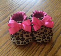 These fun and fashionable soft baby shoes or booties are great for indoor play! This leopard print is super popular and the hot pink bow just makes these shoes
