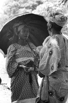 nigerianostalgia:  A beautiful Yoruba woman chatting with an...