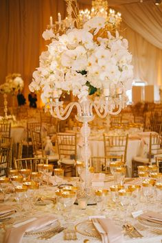 Exquisite centerpiece and table setting. Photography by Sarah Maren Photography.
