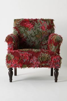 Reverse Rug Chair: Classic arm chair covered with shaggy roses from handwoven rug. Almost looks alive. $998 #Chair #Reverse_Rug_Chair