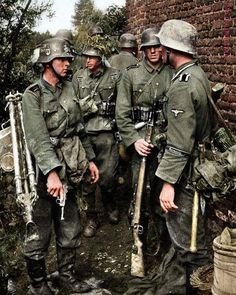 """Waffen SS soldiers with """"Germania"""" cuffs on their uniforms belonging to the SS Panzer Divison """"Wiking"""", take a break during a lull in… World History, World War Ii, Mg34, Germany Ww2, German Uniforms, Ww2 Uniforms, German Army, Hiroshima, Panzer"""
