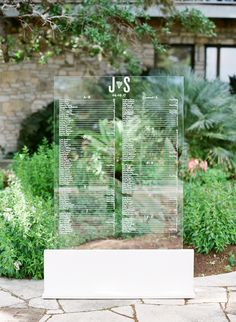 This see-through chart displayed a seating directory, as well as the couple's initials, wedding date, and a cactus motif.