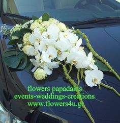wedding car decorated with white orchids by Flowers Papadakis