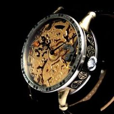 """I am happy to offer for sale this beautiful amazing large skeletonized dress Noble Design watch that dates to 1919 and decorated of the HIGHEST QUALITY ENGRAVING with BLACK STONES. It was made by the """"Omega Factory"""" in Switzerland.  #watches #menswatches #vintage#vintagewatches #vintagemenswatches#wristwatches #audemarspiguet#buywatches #buyvintagewatches#buyvintage #patekphilippe #rolex #iwc#omega #antiquewatches #antique#oldwatches #fashion #fashionwatches#luxury#wandolec"""