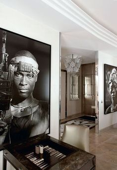 Interior architect Stephanie Coutas. Photographer: Jean-Marc Truism. In the lounge, two huge photos of children warriors in Liberia signed by Patrick Robert.