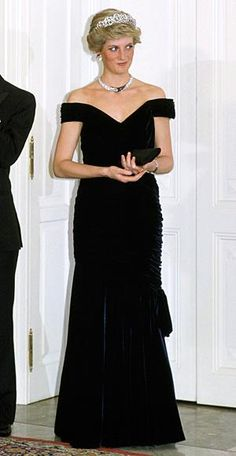 Princess Diana  (1987) Victor Edelstein based this navy velvet column gown on Edwardian evening designs. The princess famously wore it for a spin on the White House dance floor with John Travolta.