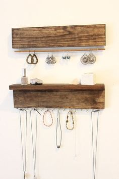 Never have tangled necklaces again! Great for Mothers Day!  This wall jewelry organizer set is the perfect way to display your favorite pieces. Every piece is hand made and may vary in appearance due to the distinct look of different pieces of wood.  The top wooden piece comes with a wood rod that slides out for easy access to your bracelets and dangle earrings. This piece measures 16 long and 1.75 inches high (without rod) and comes ready to hang.  Bottom piece measures 16 long by 4.5 in…