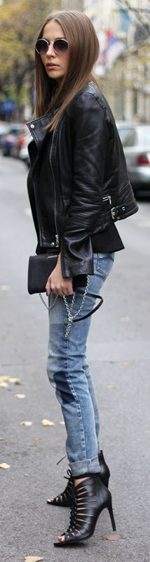 Style up a classic leather jacket and jeans outfit by adding funky heels like this gladiator style pair, worn by Vanja Milicevic. Via Just The Design. Jacket/Sandals: Zara, Jeans/Top: Armani Jeans.