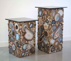Sliced agate tables covered with mineral and gems
