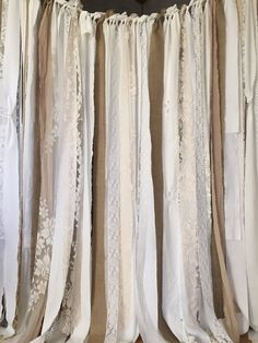 Lovely Burlap Garland Curtain Stunning burlap garland...perfect for event!!  White, Off White, Ecru, and a touch of Champagne Fabric , Vintage - New and Eyelet Lace  Approximate 6 drop with a few mixed shorter pieces to give it a little more of a shabby look. (If you need a longer drop, just convo me, BUT PLEASE NOTE, I no longer make custom drop lengths longer than 7.5 down.)  Strips tied on to Heavy duty organic twine with 1.5 foot tie off on both ends Please expect some fraying and…