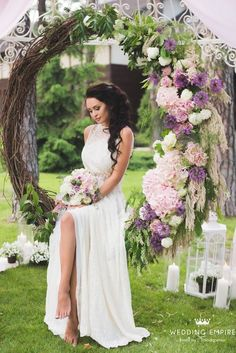 11 More Giant Wedding Wreaths: The Hottest Wedding Trend: #3. Oversized wreath with lilac-colored and blush flowers on one side used as a swing