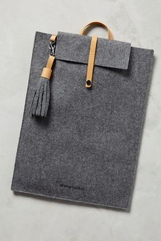 Protect your laptop in this simple, but stylish, felt case with leather accents.Sherpani Felt & Leather Tech Case, $42, available at Anthropologie.  #refinery29 http://www.refinery29.com/2016/11/128390/cheap-tech-gadgets#slide-28