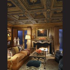 With its refurbished antique coffered ceiling, the library is one of the most dramatic living spaces. The stone fireplace surround is another item imported from Europe.