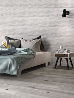 Dymo Wavy White large-format ceramic tile recommended for backsplashes, shower surrounds, and accent walls in both residential and commercial properties. Accent Wall Bedroom, Accent Walls, Furniture Layout, Bedroom Furniture, 3d Wall Tiles, Shower Surround, Stone Slab, Downstairs Bathroom, Design Lab