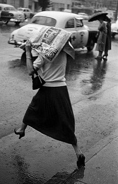 Puddle jumping woman, caught in the rain, from the Love these candid vintage photos. Walking In The Rain, Singing In The Rain, Rainy Night, Rainy Days, Black White Photos, Black And White Photography, Vintage Photographs, Vintage Photos, I Love Rain