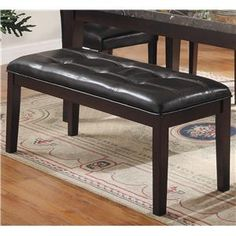 This clean, casual, and sophisticated dining bench will add a versatile seating option for your dining room. The deep espresso finished wooden legs, paired with the tufted upholstered seat, add a refined touch while its simple and clean design keep this bench casual and practical.