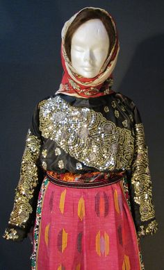 Close-up of a traditional festive costume from the Sandıklı district (Afyon province).  Style of 1950-1975. The black shirt is adorned with metal sequins and 'tel kırma' embroidery (motives obtained by sticking narrow metallic strips through the fabric and folding them).  (Kavak Costume Collection-Antwerpen/Belgium).