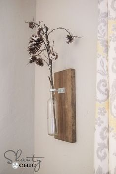 DIY Wine Bottle Wall Vase... So cheap and easy!  Great gift idea!