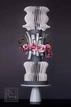 Amazing modern wedding cake design by Myton Ouano of Antonio's kitchen created for American Cake Decorating magazine. The pink orchids just finish this bold piece beautifully