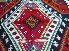 Рашићева шара, совељћа у средини. Pirot kilim is a unique, authentic and highly regarded brand of flat tapestry-woven carpets or rugs, made of pure sheep's wool from Stara Planina, southeastern Serbia, dyed with natural colours and long enduring. It is made as a single piece, has 28 weave lines in 1cm and both sides of the rug can be used. Its colors, patterns and ornaments are unique: 96 of them are geographically protected. Pirot kilim is made exclusively in Pirot, Serbia.