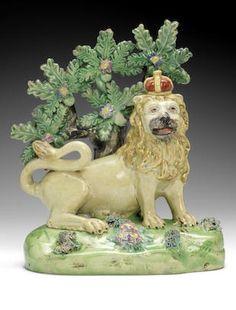 A John Walton model of the Royal Lion, circa Antique Pottery, Pottery Art, Bird Sculpture, Sculptures, Art Nouveau, Staffordshire Dog, English Pottery, Carlton Ware, Ceramic Animals