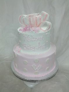 Baby shower cake. Pastel pink polka dots and baby feet, so delicate.