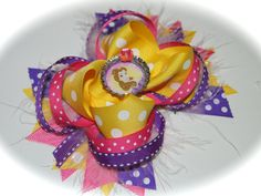 Pink purple and yellow Belle Disney Hair Bow by BlueMonetCreations, $11.00