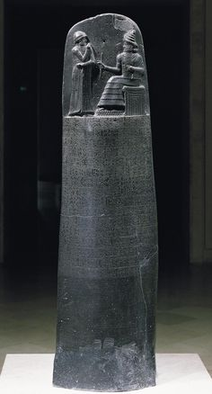 Law code of Hammurabi, basalt, Babylon, 1792-1750 BCE. Carved in Babylonian, depicts Hammurabi with ring and staff depicting kingship. Erected in Babylon, discovered in Susa where it had been removed as war booty. Stele also represents longest surviving text from Old Babylonian period.