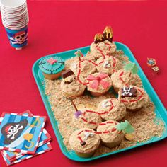 "Ahoy! Pirate enthusiasts and adventure seekers are sure to dig this island trove of treats. Bestow a special honor on the birthday boy by presenting him with the ""X"" cupcake filled with an edible treasure (scoop a well from its center, place a candy inside, and frost over it)."