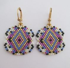 These earrings are my own original pattern - Copyright 2016 - Patti Ann McAlister.  These pretty & very lightweight beadwoven earrings are handmade one bead at a time, with silver-lined violet, matte periwinkle, opaque cream, black, & Duracoat galvanized golden delica seed beads. They measure just around 1-1/2 long which includes the plated leverback earwire, & 1 wide.