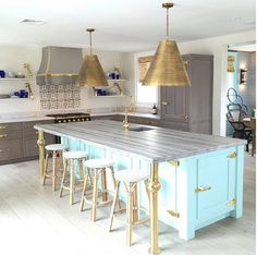 Turquoise Kitchen Island. Kitchen with turquoise island and brass kitchen pendants. Brass kitchen pendants are the Goodman Hanging Lamps. #TurquoiseKitchen #TurquoiseKitchenIsland #BrassKitchenPendant Colleen Bashaw.