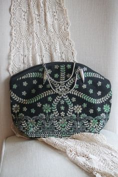 Presenting a charming black and green brocade handbag with silver tone handle and clasps. Condition: excellent vintage condition without wear
