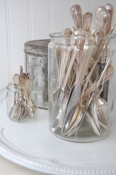 Big glass jars as silverware holders, beautiful