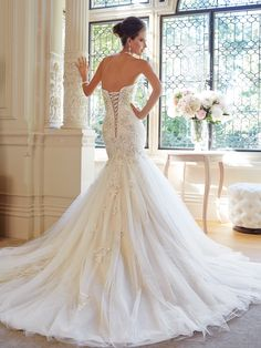 Style Y21448, Tilda, is a beautiful strapless trumpet wedding dress with chapel train designed by Sophia Tolli, click here for more details.