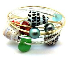 http://www.bellabeachjewels.com/collections/beach-bangles/products/silver-spotted-cone-shell-bangle
