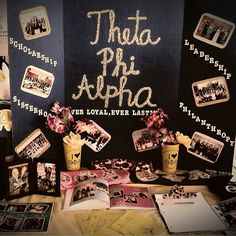 This is an excellent example of tabling!   Simple and visually pleasing...the photos have borders, and the lettering is easily read at a glance, good use of symmetry, too.  Theta Phi Alpha spring recruitment table