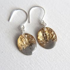 grey earrings with gold leaf and glitter on by tinygalaxies
