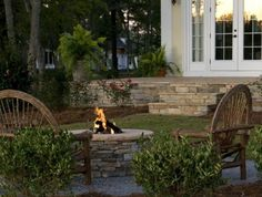 Like the open patio that steps down into green grass.  Nice firepit.