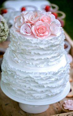 Delicate white ruffle wedding cake with roses ToniKami Pâtisserie
