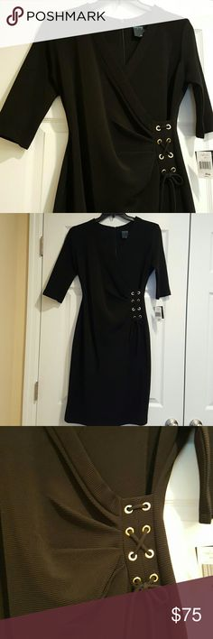 """Gorgeous Gabby Skye Black Dress This dress crosses in the front and has a beautiful design with gold rings laced and tied to the side. The dress is 40"""" long. It has 3/4 sleeves. Was $98.00 got for 89.99 as shown on tag. Gabby Skye  Dresses"""